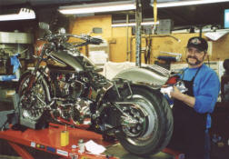 Carl installing L.E.D. turn signals on Barry Broom's 1997 FXST