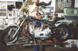 Josh working on Evelyn Cole Barth's 2001 FXST making it a 95""